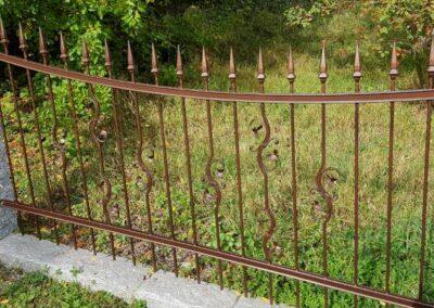 Zaun aus Schmiedeeisen in Kupfer-Antik